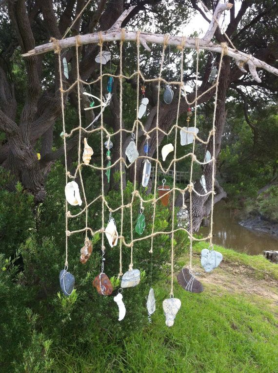 """sea dream catcher 'cache' - some lovely ideas here ... the beach one with shells is also nice - love the idea of a net to """"catch"""" all the natural trinkets"""