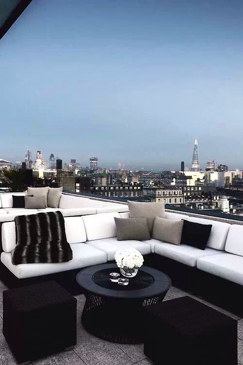 Penthouse Views.  Black & white lounge seating with a view to die for.