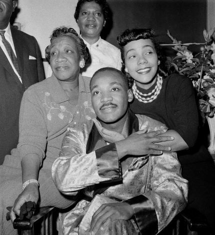 Dr. Martin Luther King, Jr., is embraced by his wife Coretta Scott King during a news conference at Harlem Hospital in New York, Sept 30, 1958, where he is recovering from a stab wound following an attack by a woman. At left is his mother, Alberta Williams King. (AP Photo/Tony Camerano) Photo: TONY CAMERANO, STF
