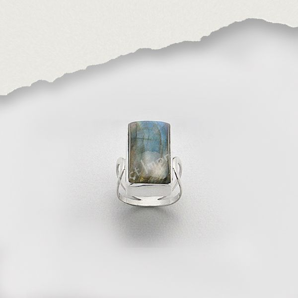 This Labradorite Bezel Set Sterling Silver Ring . When light hits it creates a rainbow of colours