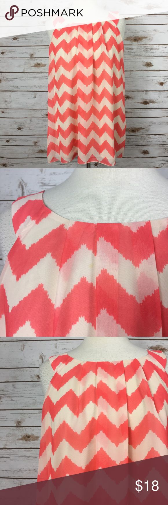 """Maurices Coral Chevron Sleeveless Blouse Fun and flirty coral chevron sleeveless tank by Maurices. • 28"""" long • 22"""" pit to pit • Small stain on front • Otherwise in good condition  🚭 Smoke-free home 📬 Ships by next day 💲 Price negotiable  🔁 Open to trades Maurices Tops Blouses"""