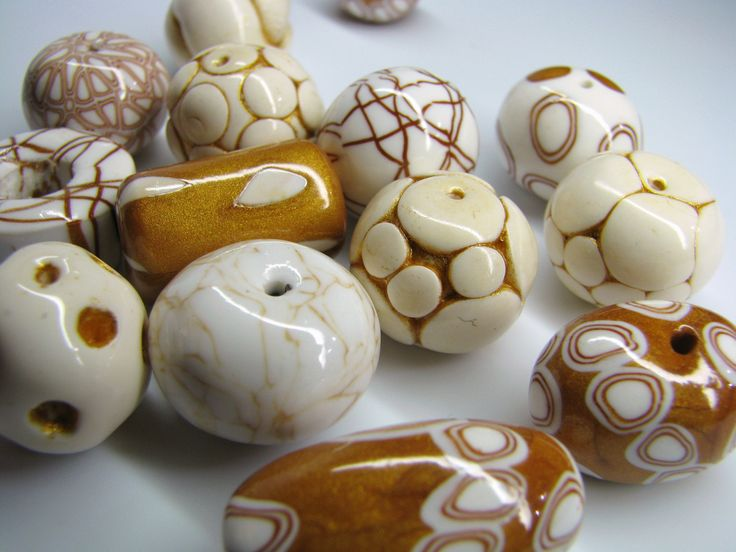 polymer clay beads sanded and buffed to a glossy shine by maria theresia bizal