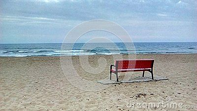 Red bench on the beach, all benches should be like this, to read quietly in front of the sea