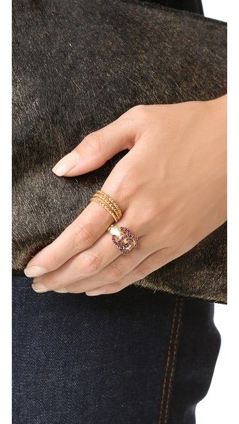 A previously owned Chanel ring with an etched band and crystal-studded logo.  14k gold plate. Made in France http://rstyle.me/n/b5mi6srm5w