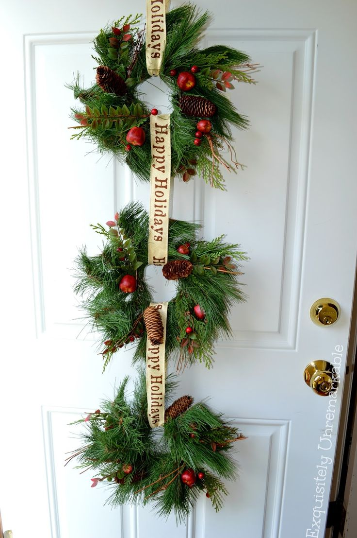 Last year I took three old faux wreaths, strung them together with dollar store ribbon and, poof, I had a fabulous new front door d...