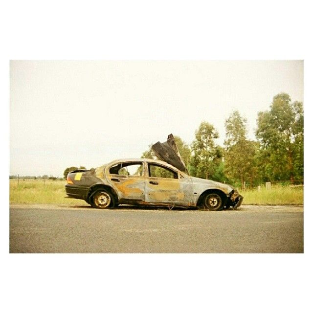 diversal:  the end of a joyride #carwreck #burntcar #35mm #pulpmatter