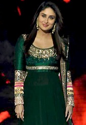 A desire that evokes a sense of belonging with a striking details. The dazzling green georgette churidar suit have amazing embroidery patch work is done with resham, zari, sequins and lace work. Beautiful embroidery work on kameez is stunning. The entire ensemble makes an excellent wear. Matching santoon churidar and dupatta is available with this suit. Slight Color variations are possible due to differing screen and photograph resolutions.