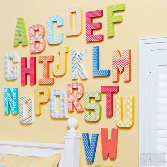 Transform crafts store letters into cheery works of art with bright paint and paper. Simply trace the letter on the back of patterned paper and cut out. Paint the wooden letter and let dry. To finish, glue the patterned paper to the painted letter and hang! /