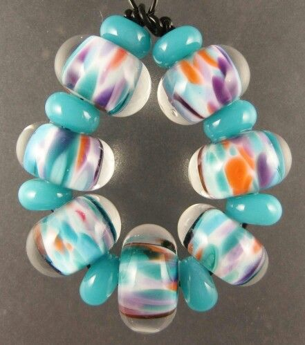 cool blend this bead set was made with system 96 glass are x to x hole size is approx