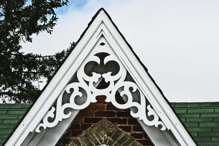 This is one example of trim that I think would be about the right size for the large gable. The peak in the photo is more acute than the angle on our house, but the mass of the decoration is about what I'm going for and the chunkiness of the piece is right -- not too delicate.