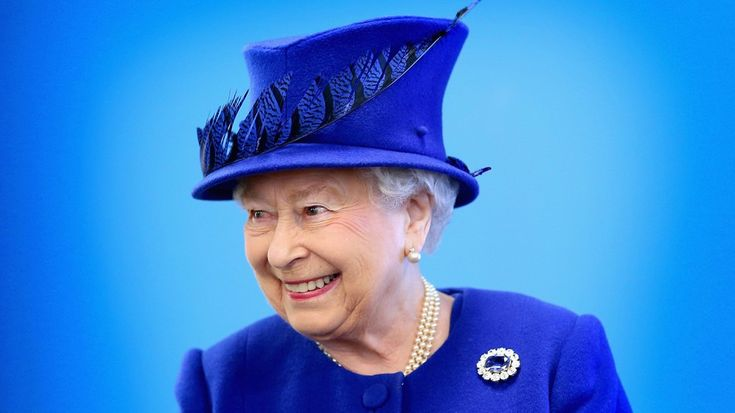 The Queen poses in fancy sapphire jewels to mark her historic Sapphire Jubilee