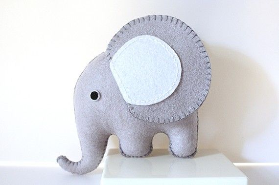 I love elephants.   I love felt.  This would make a cute Christmas ornament.   Pattern on etsy.