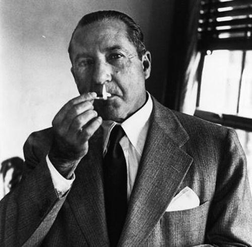 Frank Costello enjoying a cigarette