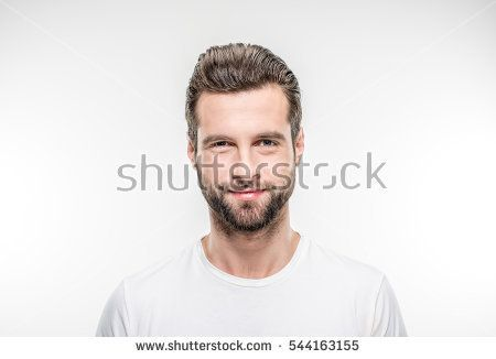 Smiling young man looking at the camera on white