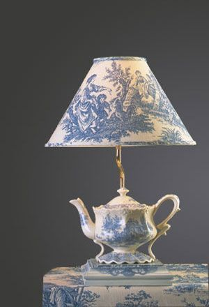 love blue and white Toile prints and fabric depicting a pastoral theme.