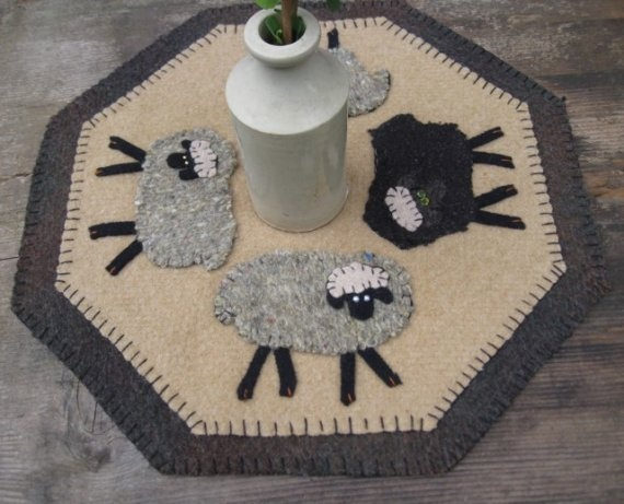 A Flock of Sheep-Wool Penny Rug Table Mat   ~~~~  I like the shape and the sheep (drt)