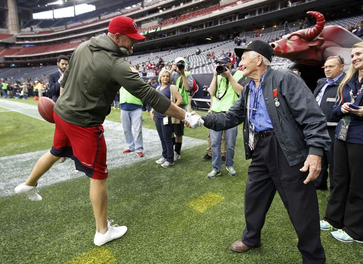 Houston Texans defensive end J.J. Watt (99) shakes the hand of a veteran before the start of an NFL football game at NRG Stadium on Sunday, Nov. 22, 2015, in Houston. ( Karen Warren / Houston Chronicle )
