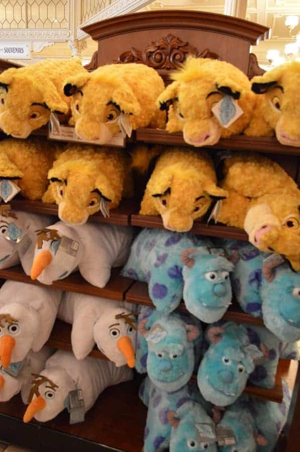 10 Of Our Favorite Disney Souvenirs To Buy Disney Souvenirs Disney Pillow Pets Animal Pillows