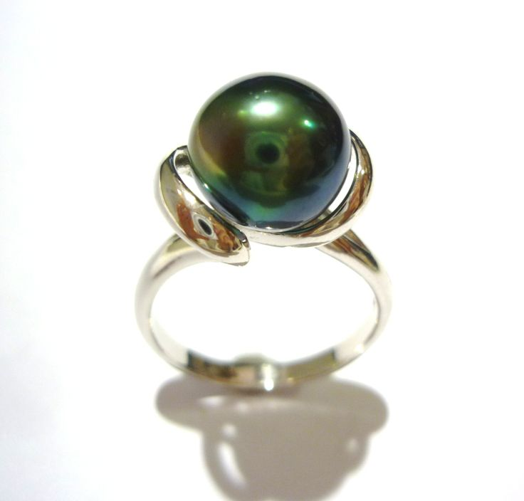 This Tahitian beauty is set in a contempory stirling silver design. #silver #tahitian #pearl