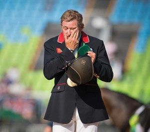 British show jumper Nick Skelton is overcome with emotion after winning the individual gold medal with Big Star.