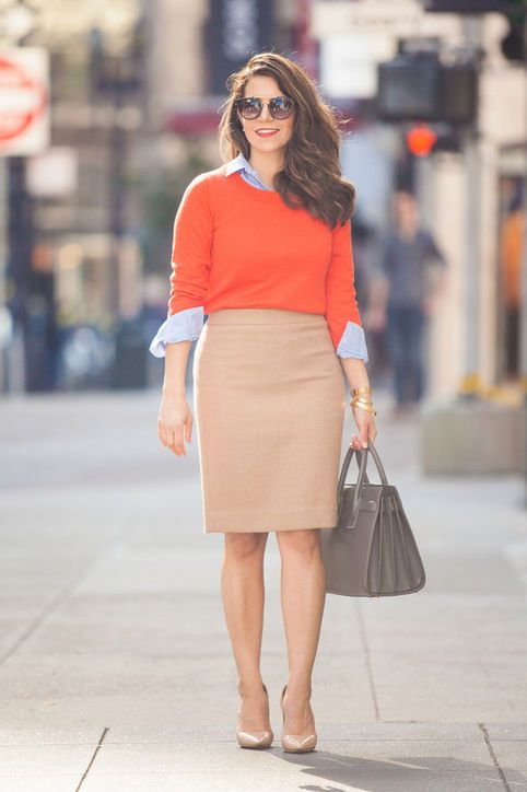 from corporate catwalk via glamour: pencil skirt, sweater over button up shirt