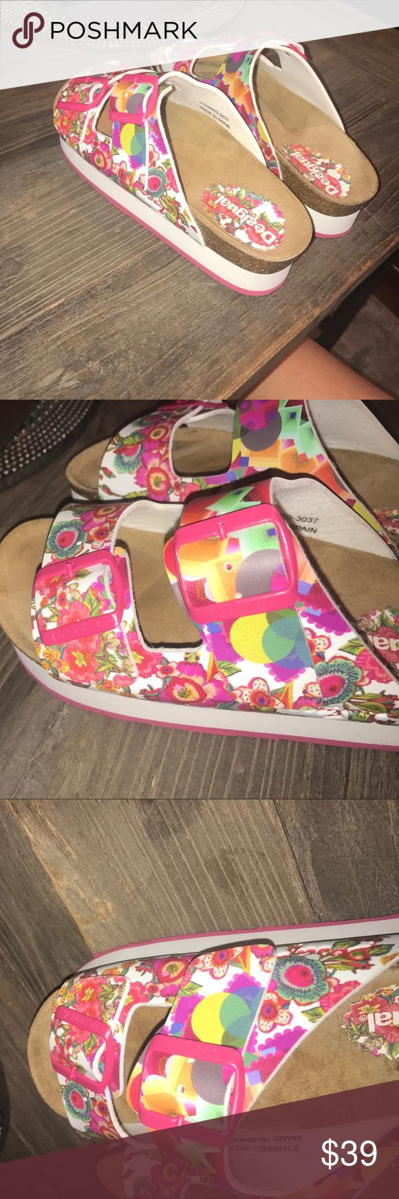 Desigual Floral Pink Tone Platform Slip On Sandal NWOT. NEVER WORN. This Desigual womens platform flip flop sandal is a 'must-have' for your Spring/Summer wardrobe. This elegant patterned sandal is perfect for the beach or pool. It is built for style and comfort with its gorgeous adjustable pink patterned signature strap and moulded foot bed. This sandal would lend itself brilliantly to any summer outfit. Desigual Shoes Sandals
