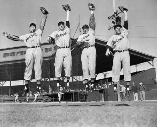 Members of the Detroit Tigers outfield — Rufus Crawford, Al Kaline, Bill Tuttle and Jim Delsing — leap into the air during a 1954 spring training practice in Lakeland, Fla. (AP Photo/ Preston Stroup) GALLERY: Classic Photos of the Detroit Tigers