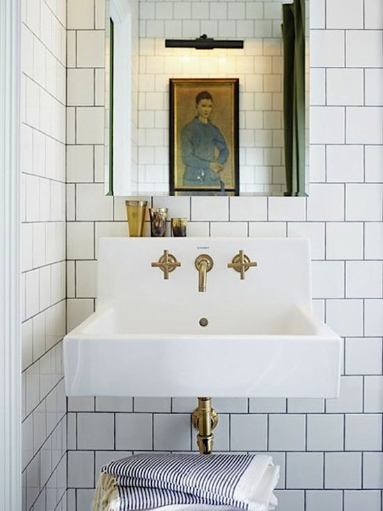 brass fixtures and subway tiles. #bathroom #interiors #decor