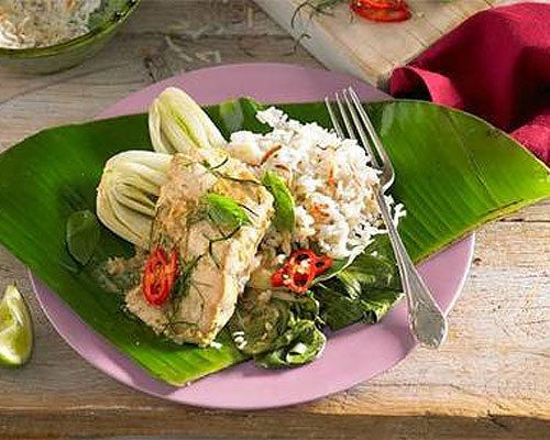 Coconut fish in banana leaf