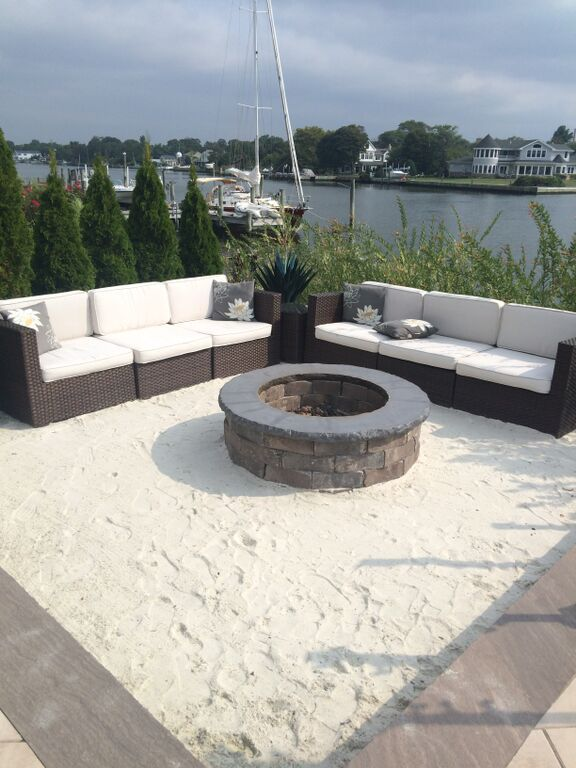 Imagine sitting by the fire with your toes in the sand. Bring the sand to your backyard, with Cambridge Fire Pit Kits.