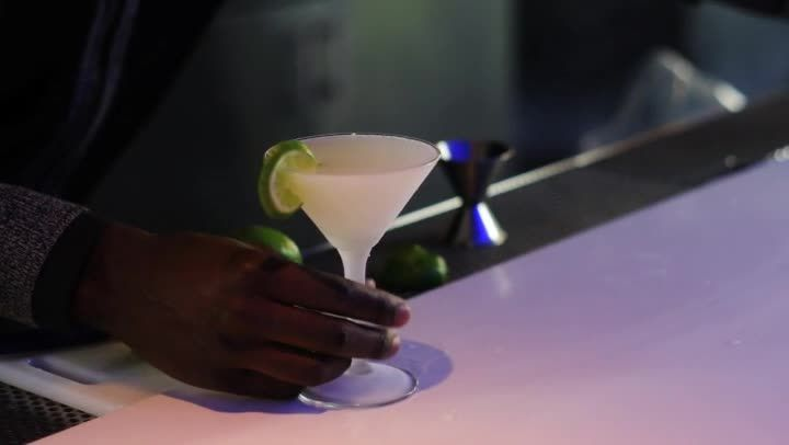 Making margarita martinis uses triple sec and fresh lime. Make margarita martinis with help from the bar manager at the W hotel in Atlanta Georgia in this free video clip.