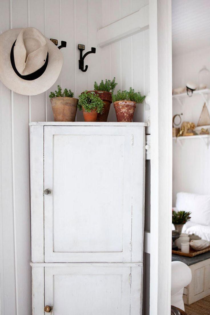 Fix corner cupboard to wall