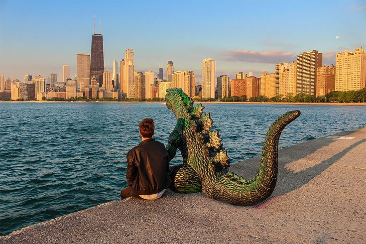 """According to photographer Kieran Murray: """"You've heard of the travelling gnome, now I present a travelling Godzilla figurine that I have photoshopped to look life sized. His name is Ryan and we travel all around, getting into all sorts of shenanigans.   Travelling on your own is awesome, but it ca"""