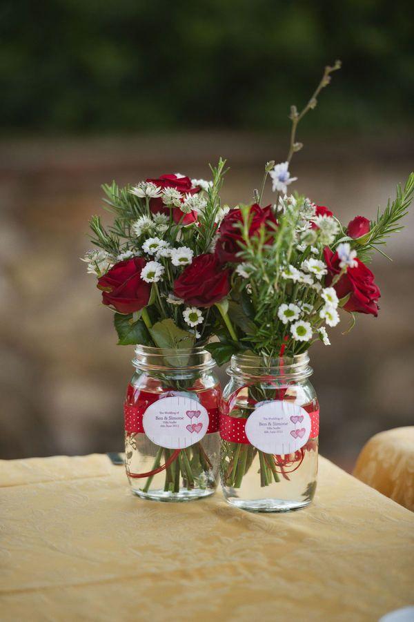 pots de vidre amb flors amb etiquetes persosalitzades