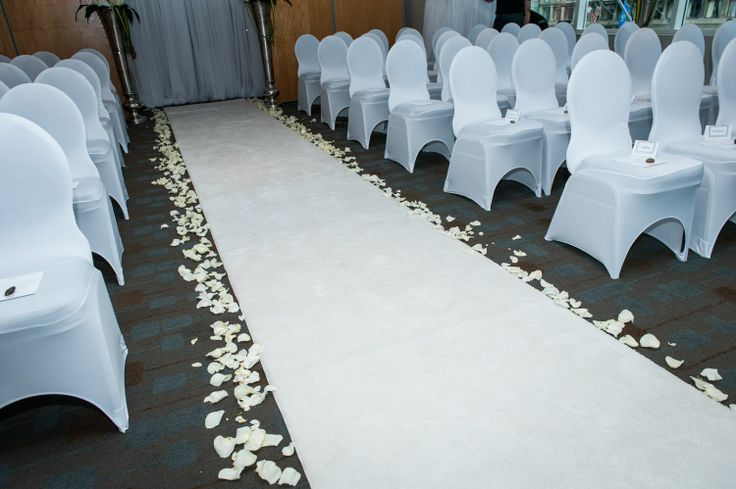 We rented a white runner,  the hotel only had a traditional red one,  I love the overall white effect with the petals.
