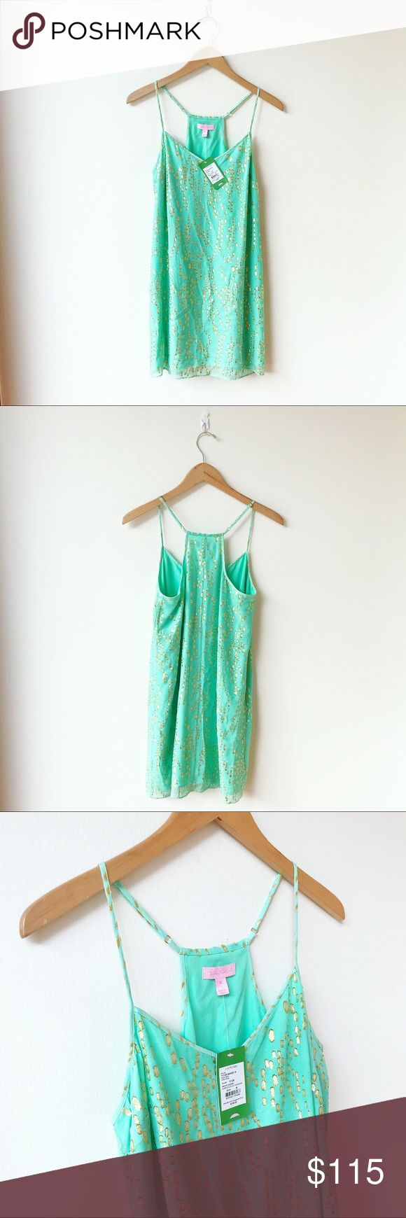 Lilly Pulitzer Green Mini Beach Glass Dress Kelly green mini dress with skinny, adjustable straps, coming to a slight racerback. Gold shimmer flecks throughout. Fully lined. Beach Glass style. NWT for $198! Lilly Pulitzer Dresses Mini