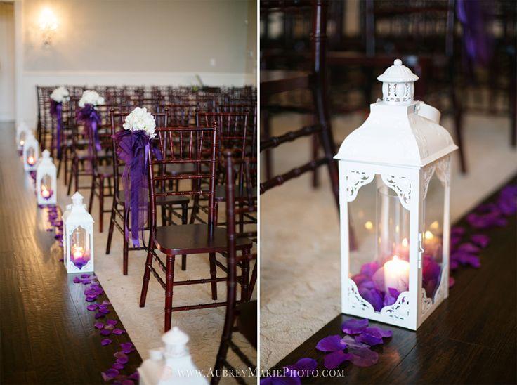 Wedding ceremony aisle decorations lanterns purple for Wedding ceremony table decorations
