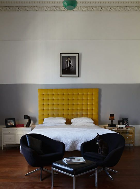 I adore this great lamp hiding at the top of the photograph, it really draws in the symmetry and complements the yellow headboard.