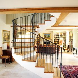 Farmhouse Staircase by CCD Architects