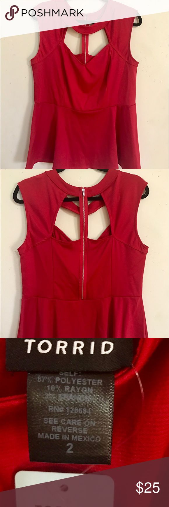 NWT Torrid Red Peplum Top (2x or 18/20) This super sexy red peplum top has such fun details! A zipper up the back, cut out chest area, etc. New with tags. Make me an offer! Or check out and bundle with my other items for a discount. torrid Tops Blouses