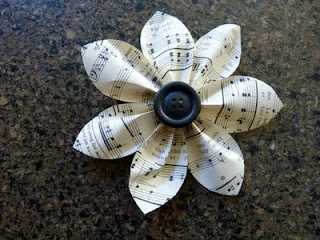 flower made of paper (can use old scrap paper) and use a bottle cap as the center instead!