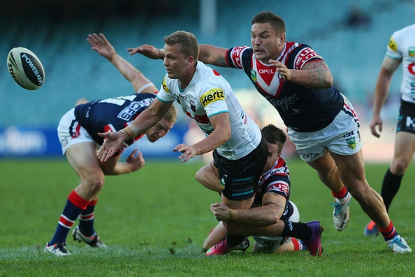 Matt Moylan .of the Panthers offloads the ball in a tackle during the round eight NRL match between the Sydney Roosters and the Penrith Panthers at Allianz Stadium on May 5, 2013 in Sydney, Australia.