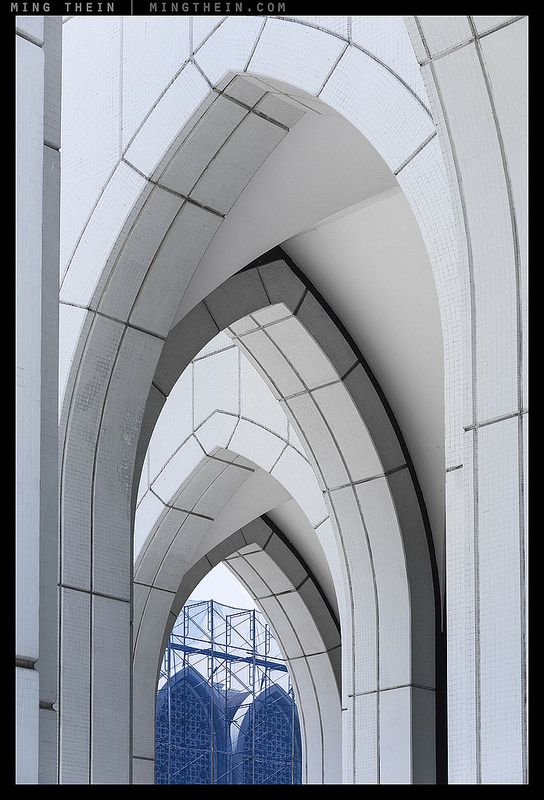 Arches and blue.  Image by Ming Thein.