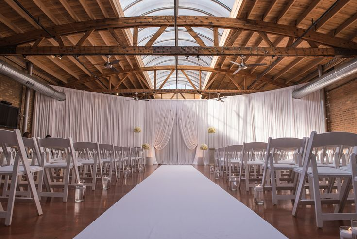 Gorgeous exposed wood and  brick wall wedding venue. White fabric draping for wedding ceremony. Rustic wedding venue. Industrial wedding venue. Midwest weddin venue. Chicago wedding venue. Venue: Loft on Lake | Photography: Thara Photo | Planning: Elisa, The Simply Elegant Group | Draping: Art of Imagination | Floral:   Gratitude Heart Garden | Catering: FireFly | Cake: West Town Bakery | Bar: Binny's | Reception: Toast & JamTransportation: Windy City Limo
