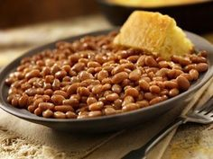 These slow baked beans can be made with navy beans or yellow-eye. The beans are flavored with salt pork, brown sugar, and ketchup.