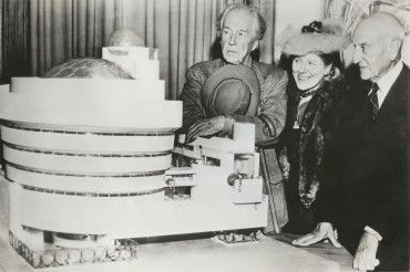 Frank Lloyd Wright, Hilla Rebay, and Solomon Guggenheim with a model of the…