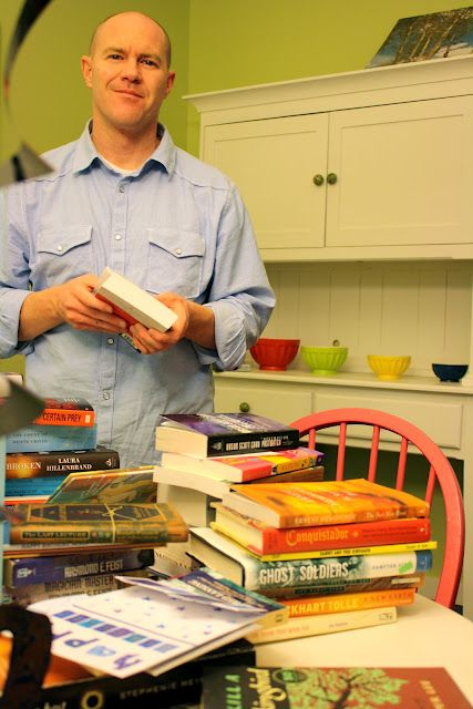 For his 40th birthday, his wife contacted 40 friends/family to send their favorite book to him as a gift.    Best bookworm gift idea EVER.