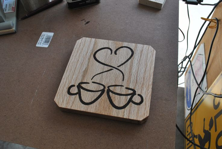 Coffee cups hot plate. I burned the patterns onto a strip of oak wood.