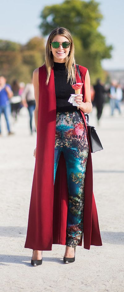 A red long vest paired with printed trousers