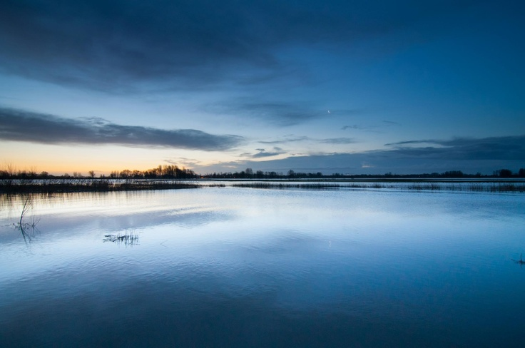 Sun ries slowly over the flooded floodplains alongside the river Merwede near the city of Gorinchem.